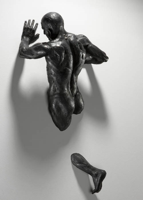 Sculptures Emerge from Walls017